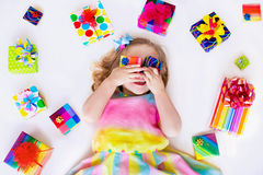 Little girl with birthday presents Stock Photos