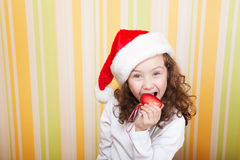 Little girl bites a heart Royalty Free Stock Photo