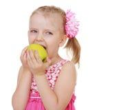 Little girl biting stock photo
