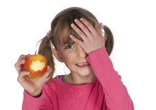 Little girl with bitten apple Royalty Free Stock Photo