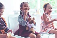 Little girl bitting gold medal for student award. Little girl is bitting gold medal for student award stock photography