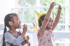 Little girl bitting gold medal for student award stock photos