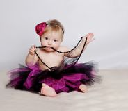 Little girl with black beads stock photography