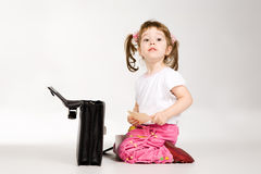 Little girl with black briefcase Stock Photo