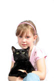 Little girl with black cat. This little girl was sad until she found her cat Royalty Free Stock Photos
