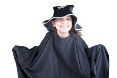Little girl in black cloack and hat. Smiled Royalty Free Stock Image