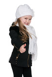 Little girl in the black coat holds her thumb up. A little girl in the black coat holds her thumb up on the white background Royalty Free Stock Image