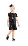 Little Girl in a Black Dress Posing Stock Photography