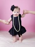 Little girl in black dress in studio Royalty Free Stock Photos