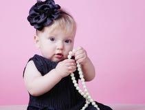 Little girl in black dress in studio Royalty Free Stock Photos