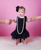 Little girl in black dress in studio Stock Photo