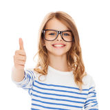 Little girl with black eyeglasses Royalty Free Stock Image