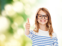 Little girl with black eyeglasses Royalty Free Stock Images