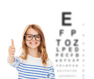 Little girl with black eyeglasses Stock Photos