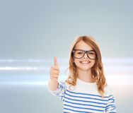 Little girl with black eyeglasses Royalty Free Stock Photography