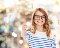 Little girl with black eyeglasses Stock Image