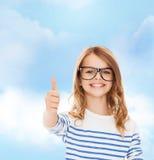 Little girl with black eyeglasses Royalty Free Stock Photo