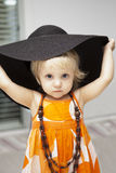little girl in black hat Royalty Free Stock Image