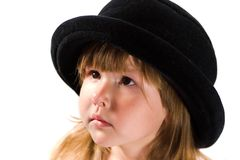 Little girl in black hat Stock Image