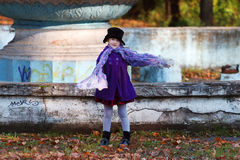 Little girl in black hat poses with scarf Royalty Free Stock Photo