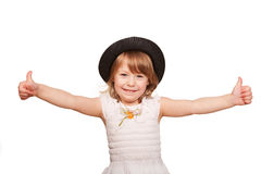 Little girl in a black hat showing thumbs up sign. Royalty Free Stock Image