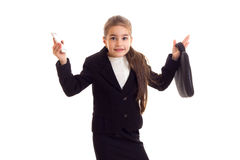 Little girl in black jacket holding diploma and smartphone Stock Photo