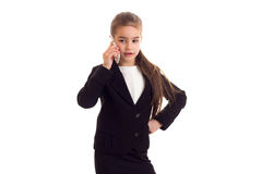 Little girl in black jacket talking on phone Royalty Free Stock Images