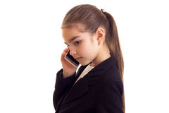 Little girl in black jacket talking on the phone Stock Images