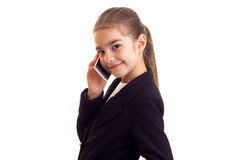 Little girl in black jacket talking on the phone Royalty Free Stock Image