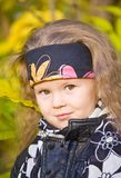 Little girl in a black leather jacket and bandana Royalty Free Stock Image