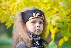 Little girl in a black leather jacket and bandana Royalty Free Stock Photos