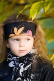 Little girl in a black leather jacket and bandana Stock Image