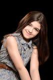 Little girl on black Stock Photography