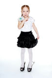 A little girl in a black skirt and white blouse Stock Photo
