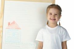 Little girl and blackboard Stock Images