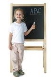 Little girl and blackboard Stock Photography
