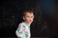 Little girl with blackboard royalty free stock images