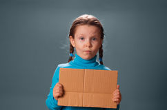 Little girl with blank poster. Stock Image