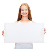 Little girl with blank white board Royalty Free Stock Photography