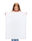 Little girl with blank white board Stock Images