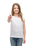 Little girl in blank white t-shirt pointing at you Royalty Free Stock Photo