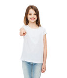 Little girl in blank white t-shirt pointing at you Stock Photos