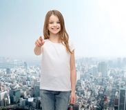 Little girl in blank white t-shirt pointing at you Stock Photo