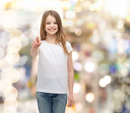 Little girl in blank white t-shirt pointing at you Stock Photography