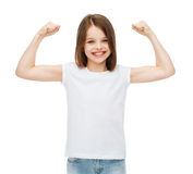 Little girl in blank white t-shirt showing muscles Stock Photos
