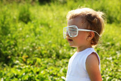 The little girl in the blinds-glasses Stock Image