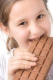 Little girl with a block of chocolate. Little girl with a big block of chocolate Royalty Free Stock Images