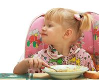 Little girl the blonde eats Stock Image