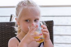 Little girl drink the juice stock images