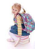 Little girl  blonde  with a school knapsack on Royalty Free Stock Photography